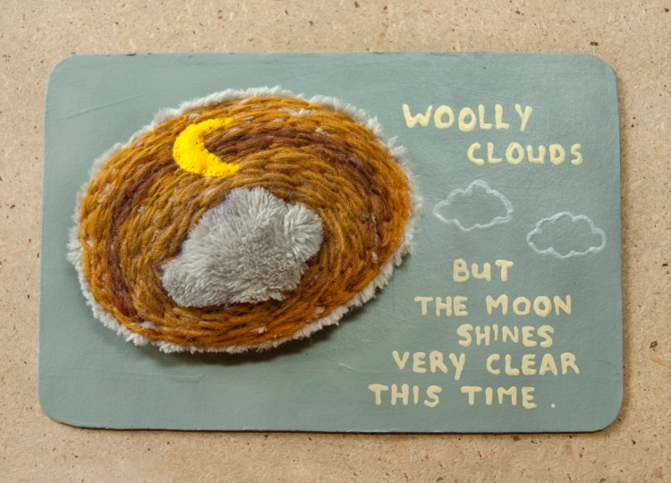 woolly clouds but the moon shines very clear this time